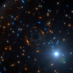 Artist's impression of the black hole binary system in NGC 320
